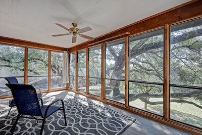 Balcony  - The screened balcony off the master has relaxing views of the tree-filled yard.