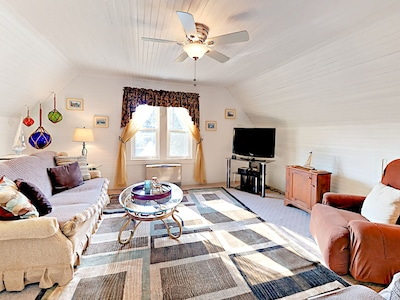 """Living Area - A 46"""" TV overlooks the gorgeous area rug in the lounge."""
