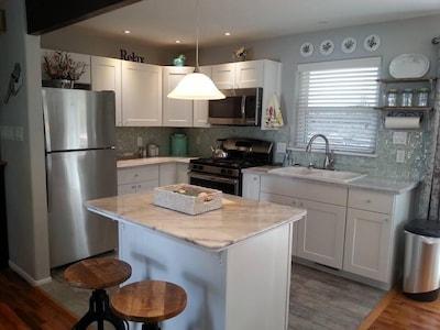 Kitchen includes can opener, mixer, blender, griddle, toaster and crock pot