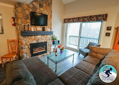 Gas fireplace to keep you warm no matter the weather outside and large wall mounted flat screen TV to make sure you don't miss out on any of your favorite shows