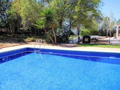 The pool is fenced for the safety of young children