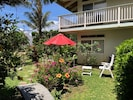 Colorful garden  for relaxation under the umbrella, sun tanning or BBQ Grilling
