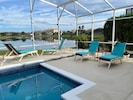 Plenty of lounge chairs to relax by the pool and the Lake