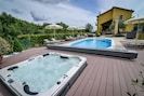 Hot tub pool and sun bathing deck.