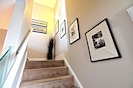 Stairwell to upstairs bedrooms.