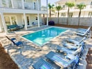 Large private pool in the backyard with plenty of lounge chairs