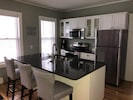 kitchen has granite counters and stainless steel appliances.