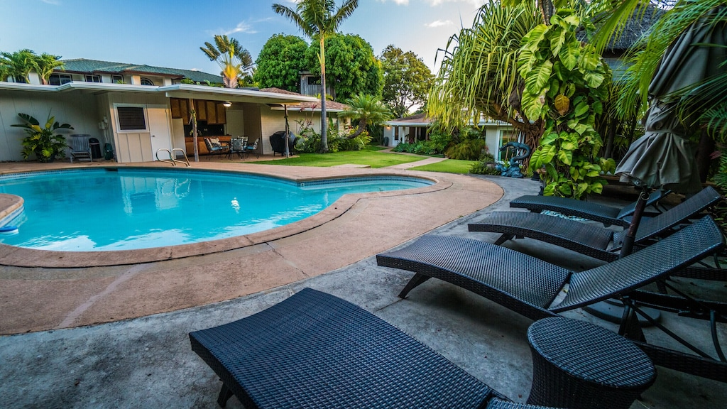 You can see the outdoor kitchen and BBQ lounge to the left at this villa on Oahu Hawaii.