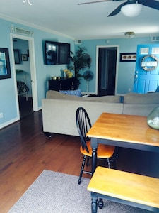 View of dining table into family room. Great open space!