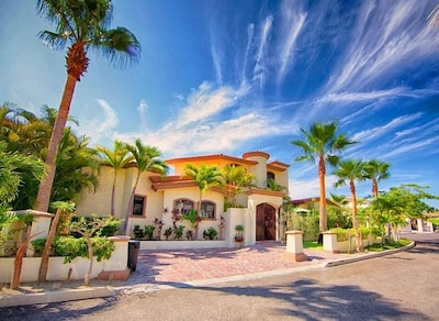 Front of Hacienda in gated community just 4 blocks from the beach. 2 car parking