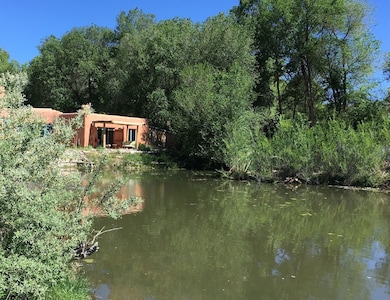 Adobe Casita on the half acre pond on our eco solar 8 acres of lush trails