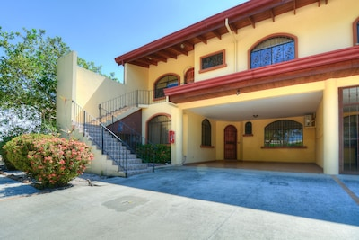 Front of condo with garage