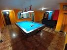 Pool table looking toward living room area & kitchen