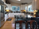 Large kitchen with subzero refrigerator and professional Viking gas stove/oven
