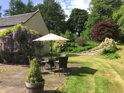 Outdoor dining area and cottage entrance