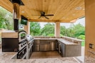NEW outdoor kitchen. Pizza oven, ice machine, grill, mini fridge and sink