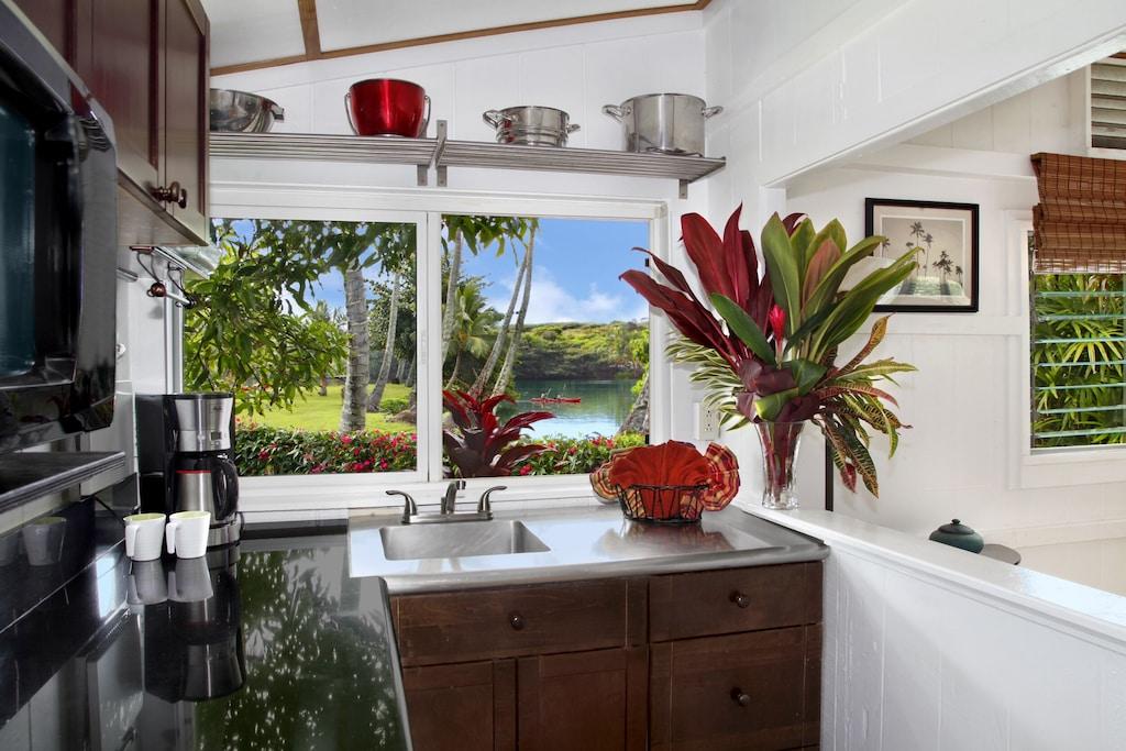Modern cottage kitchen overlooking the Wailua river in Kauai