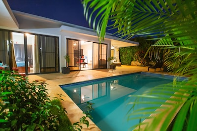 Gorgeous new villa, tropical outside view at night , direct access all rooms