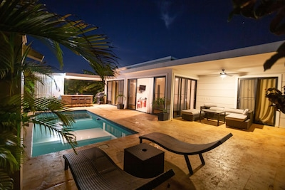 Night view of villa, patio, pool, Private bar