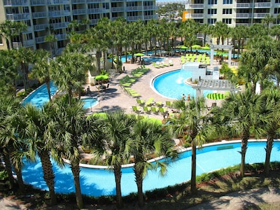 Enjoy this gorgeous view of the LazyRiver & waterfall pool from your balcony.