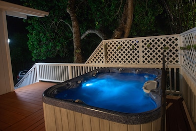 Enjoy soaking in the hot tub after a day at the beach!