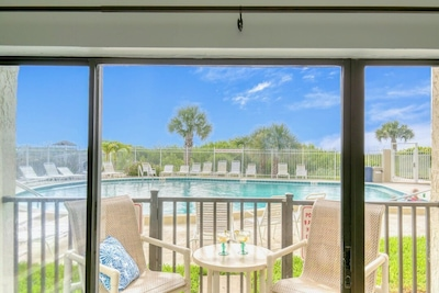 Walk right out your patio doors to the pool and beach!