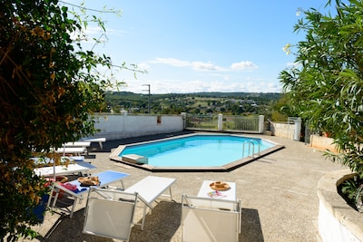 secluded swimming pool area with panoramic views