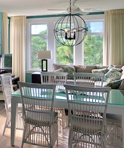 contemporary beach style with corner bay view