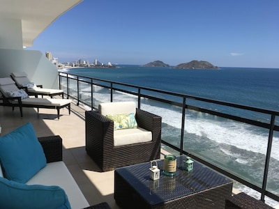Large patio with comfortable furniture to enjoy the amazing views of the city
