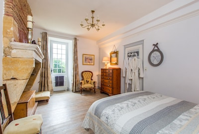 Beautifully furnished bedroom en suite, equipped with gowns and slippers