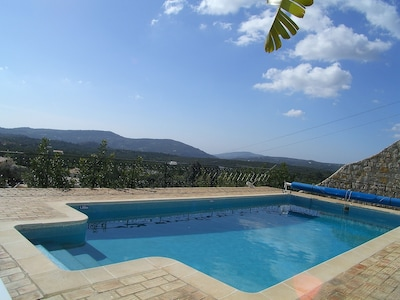 Lower terrace with a large 12m x 5m pool.with stunning views over the valley .