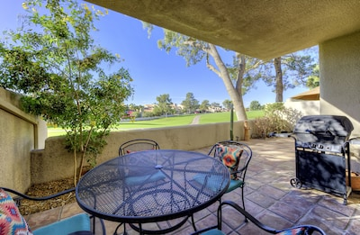 Back patio dining seating with grill, overlooking the golf course