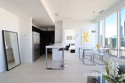Open-concept living space with floor-to-ceiling and wall-to-wall windows