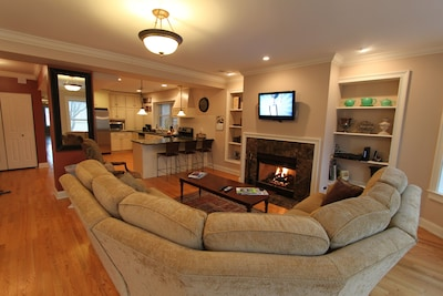 Open concept family room and cozy living room with gas start fireplace...