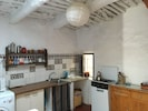 Kitchen is rustic but well equipped.