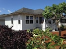 SIDE VIEW OF GUEST HOUSE;FRESH HAWAIIAN FLOWERS SURROUNDING GARDENS;BBQ ON LANAI