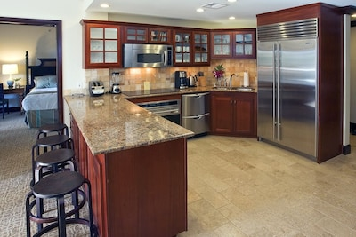 Gourmet kitchen with granite counter tops and stainless appliances.
