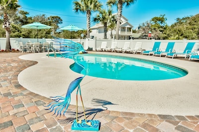 Your private tropical oasis. Grill, lounge chairs, table&chairs, corn hole game