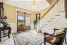 Elegant Foyer with Crystal Chandeliers
