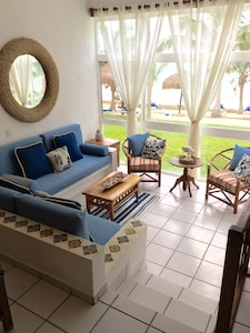 Living area with a view to the sand and water
