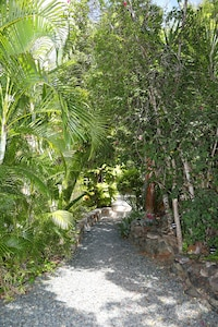 Beautifully landscaped flat path from the parking area to the villa