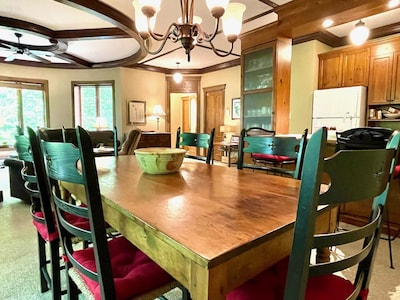 Dining room with antique, mid-19th century harvest table and seating for 6-8