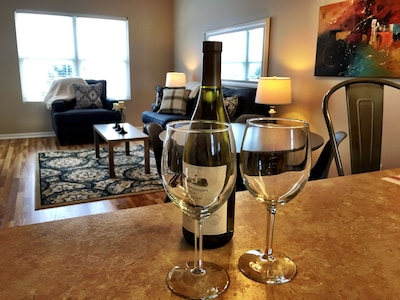 Check in, and enjoy a glass of wine!