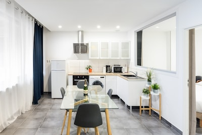 Kitchen open to dining room | 1Stays