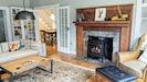 Designer living room features Jotul gas stove, original burl wood hearth