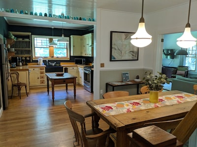 Open concept kitchen and dining area with antiques and authentic artwork