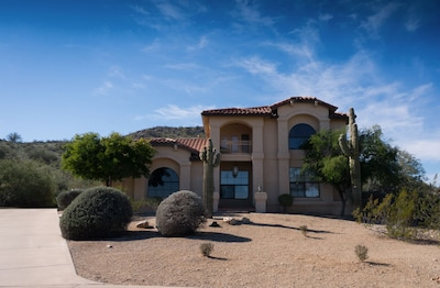 Sitting on a hill, this is your first view of Estrella Escape!  custom home