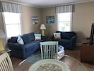 Living area and dining table with 4 chairs