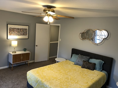 Large bedroom with a Serta pillow top mattress for comfortable night sleep.