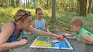 Family Fun! - Enjoying a board game outdoors on the backyard patio table.